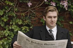 Matthew Crawley not quite reading his paper