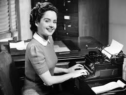 Woman with typewriter smiling