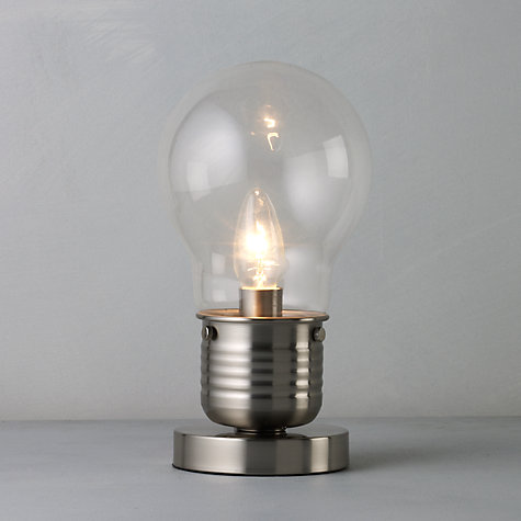 This quirky light bulb shaped lamp by john lewis would look particularly good in a minimalist or industrial chic interior the metal at the base of the lamp